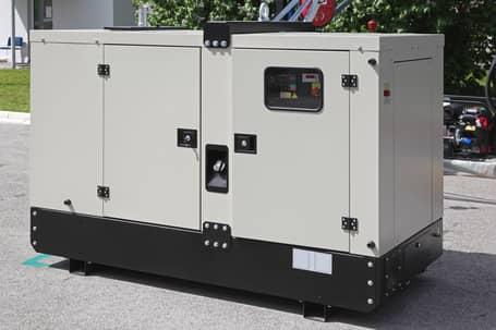 A picture of an industrial generator in a yard in Grande Prairie.