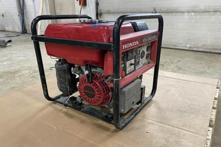 A picture of a repaired red portable generator in Ultimate Energy Controls Inc Grande Prairie Shop.